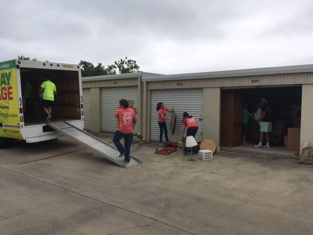 Students loading a Lockaway Storage box truck with donations.