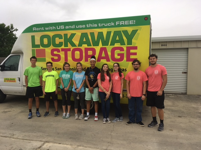 Students from Samuel Clemons High School stand in front of a Lockaway Storage box truck.