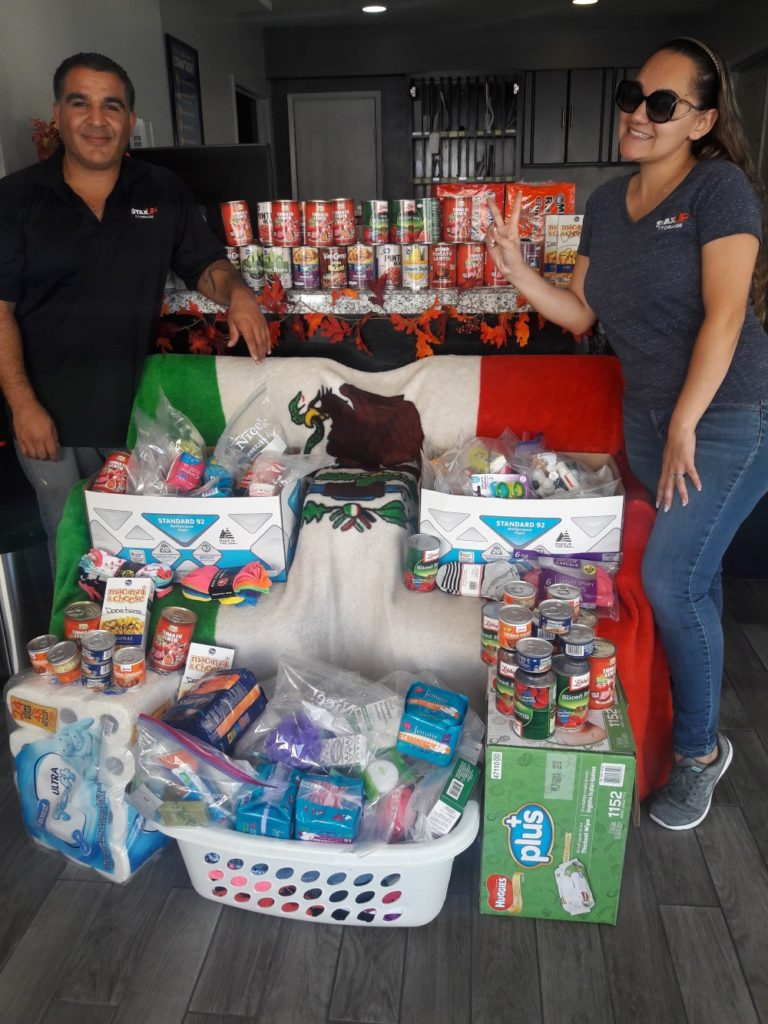 staxup storage team with donation for mexico earthquake relief