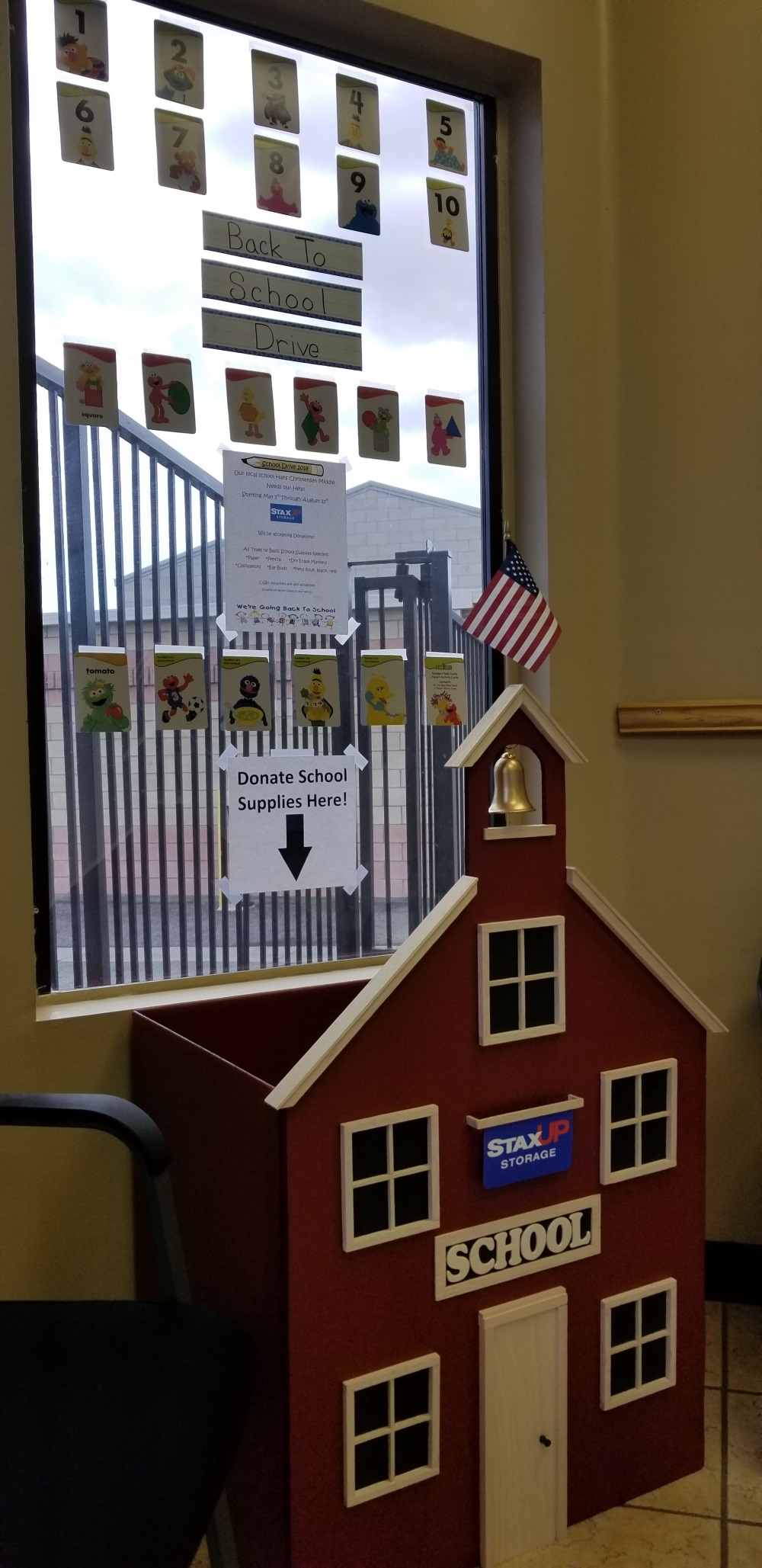 A donation box has been decorated to look like a 1-room schoolhouse.